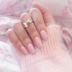 Pink nails and bow ring