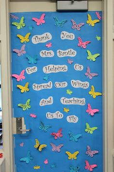 door idea. Could do butterflies, kites, birds, planes, with pics or just names.