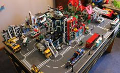 Hello Folks, Thought i would share my sons and mine Lego city. It is slowly growing and ironing out the kinks. I have modded several of the buildings to fit. Lego Track, Lego City Airport, Playroom Table, City Layout, Lego Display, Bored Kids, Lego Boards, The Kinks, Lego Table