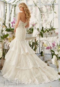 Wedding Dress 2810 Crystal Moonstone Beading Meets Alencon Lace Appliques and Scalloped Edging onto the Tiered Tulle Gown