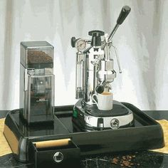 """19"""" Universal Base for la Pavoni Espresso Machines by La Pavoni. $199.00. PB Features: -Suitable for all la Pavoni lever machines and pump machines except model Duet.-Made in Italy. Dimensions: -Dimensions: 3''H x 19''W x 14''D.-Usable surface area for machine: 11.5''W x 11.5''D.-Usable surface area for grinder: 5.5''W x 11.5''D.-Weight: 8 lbs."""