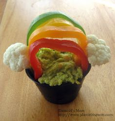Healthy St Pat's treat - hummus and peppers with cauliflower clouds.