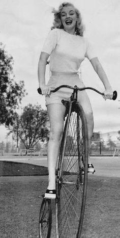 Marilyn Monroe on a penny-farthing bike in 1949