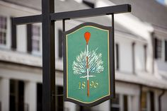 Merion Golf Club's distinctive logo greets visitors to the club that is hosting its fifth U.S. Open