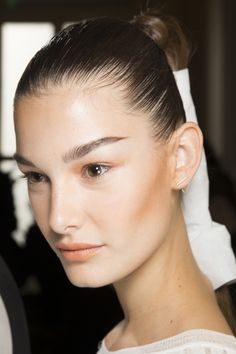 Face forecast: the beauty looks that will trend in 2016: Strong but not too strong browsBasically don't over-do the brow lining and shaping. Keep it simple but not messy. Backstage at Balmain.