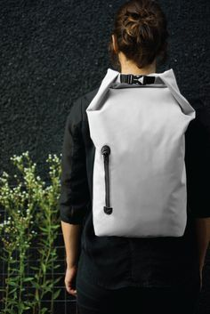 This backpack was designed with pure simplicity in mind. The goal was to achieve a minimalistic and urban look while using technical materials that would withstand weather changes on your daily commute. The beauty resides in its simple form and execution of details. The integration of natural materials like leather in conjunction with synthetic fabrics creates a nice balance. Via