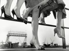 Elsner Schuhe - 1957  ByHerbert Dombrowski.He shot images of shipyard workers and ships in Hamburg harbor, female spectators at the race tracks in their elegant dresses, men at the stock exchange, people in the streets, in market places such the Fischmarkt or in the district of St. Pauli.