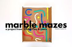 "Create a simple DIY marble maze using playdough ""snakes"" and a box lid. Learn about design and problem solving with this DIY toy."