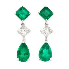 Pair of Platinum, Emerald and Diamond Pendant-Earrings  Topped by 2 square-cut emeralds, joined by 2 square-shaped modified brilliant-cut diamonds approximately 1.05 cts., suspending 2 pear-shaped emeralds, emeralds altogether approximately 4.05 cts.