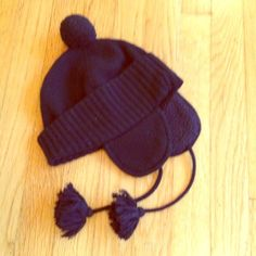 J Crew hat Cute winter hat with earflaps and pompom on top. Black wool/nylon/cashmere blend. Like new. J. Crew Accessories Hats