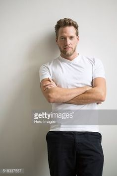 Stock-Foto : Portrait of confident blonde man with arms crossed