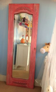 My first Annie Sloan Chalk Paint project! Rehabbed a $4 salvage armoire door! The girls love the princess mirror!