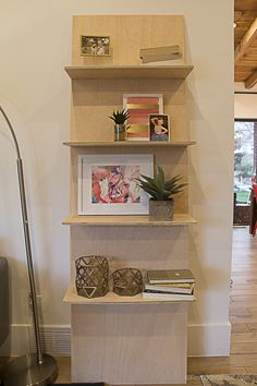 Build a minimalist plywood leaning shelf from just one sheet of plywood. Perfect for displaying photos and other lightweight home decor. #PlywoodPretty @Remodelaholic