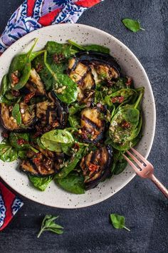 This grilled eggplant and spinach salad makes a wonderfully fresh, healthy, and filling warm weather meal. The eggplant is smoky and delicious, and the smoked paprika in the lemony dressing enhances its flavor even more. #EggplantPizzaRecipe