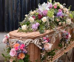 Pink and white spring coffin spray by Matthew Spriggs of Spriggs Florist