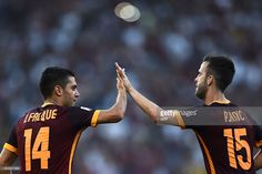 Roma's midfielder from Bosnia-Herzegovina Miralem Pjanic (R) celebrates with Roma's forward from Spain Iago Falque after scoring during the Italian Serie A football match AS Roma vs Juventus on August 30, 2015 at the Olympic stadium in Rome. AFP PHOTO / FILIPPO MONTEFORTE