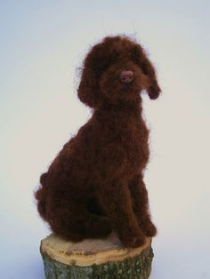 """needle felted with lovely soft chocolate alpaca fleece,hand curled.4.5"""" tall."""