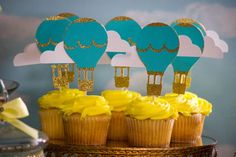 Decorated cupcakes at a hot air balloon baby shower birthday party! See more party ideas at CatchMyParty.com!