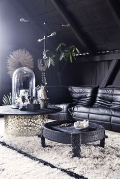 The livingroom loft at the Milla-farm in Aurskog. Home of interior stylist Camilla Berntsen. Togo sofa, table by Jonathan Adler & vintage Beni Ourain rugs.