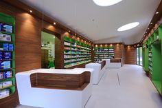 Chemist's Modern Shop interior design - great desk o place handbags etc when needing to sign