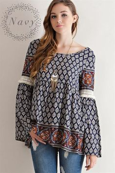 78d4cf7c98d1 Navy border print peasant blouse featuring Slightly wrapped V-shape scoop  back with tie-up strap detail. Crochet lace with fringe detail on sleeves.