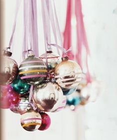 "Vintage ornaments hang from ribbons to create a holiday ""chandelier!"" How cute is this?! Christmas Balls, Pink Christmas, Vintage Christmas, Christmas Holidays, Christmas Ornaments, Hanging Ornaments, Christmas Ideas, Glass Ornaments, Merry Christmas"