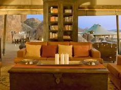 Namibia has a reputation for delivering friendly hospitality and good quality service. Your African dream desert vacation becomes real with us: Wolwedans C Luxury Tents, Luxury Camping, Timber Cabin, Best Hotels, Amazing Hotels, Rustic Interiors, Lodges, Bouldering, Interior Decorating