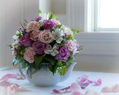 Tea party themed floral arrangement for bridal shower