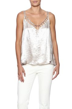 Work the free-spirited bohemian esthetic of Free People into your wardrobe the Silver Haze camisole. Boasting a sheeny metallic finish its characterized with a cut-out neckline and a crisscross detailing to the back.  Silver Haze Camisole by Free People. Clothing - Tops - Blouses & Shirts Clothing - Tops - Sleeveless New Hampshire