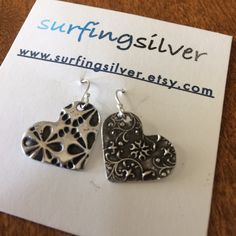 Just shipped another set of these unusual mismatched earrings. Matching or miss-matched, oxidized or bright white silver, custom jewelry offers many choices. See more at my im my shop. By Surfingsilver