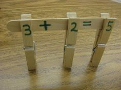 Building fact families with popsicle sticks and clothes pins.
