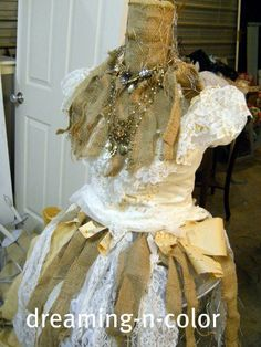 f2e9b6c86ef6 This dress form is made from chicken wire and a floor candlestick. SO  clever!