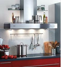 This Miele Rangehood Is Being Used As A Storage Shelf In Addition To Its Function