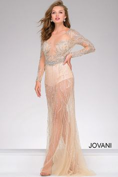 b6b02b76a1f Stunning sexy floor length sheer embellished nude pageant dress features  long sleeves and open back. jovani.com