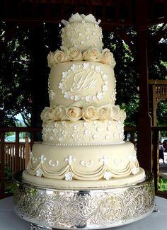 Ivory monogram wedding cake  Keywords: #weddingcakes #jevelweddingplanning Follow Us: www.jevelweddingplanning.com  www.facebook.com/jevelweddingplanning/