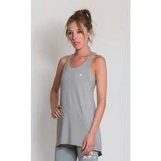 Sportsvest with draped look in grey stone and length cut and racer-back design worn with swallow-flock leggings and cross-over sportsbra Pilates Workout, Workout Fitness, Running Fashion, Fitness Fashion, Sports Vest, Grey Stone, Swallow, Activewear, Basic Tank Top
