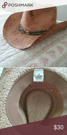 Straw cowgirl hat with turq beads Straw cowboy hat..beautiful with turq beads got in Wyoming. Wore once . The band inside is nice so most head sizes can wear it!!?? Accessories Hats