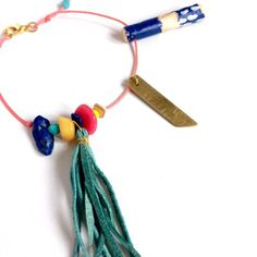 Charm brass bracelet Fine jewelry Gold brass Thin string bracelet Tassel wood bracelet Boho Chic bracelet Colorful Pink Blue gift for her This modern charm bracelet is simple, everyday piece which you can match with lots of outfits. Will give glam to your style if you wear plain t-shirt,