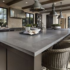 For rich, dramatic #kitchen #countertops with the sleek & trending look of concrete, Metropolis Grey #quartz is one of our favorites. Pair this versatile #quartzcountertop with warm neutrals & brushed finishes for a kitchen look that's inviting & sophisticated. #arizonatile Gray Kitchen Countertops, Gray Quartz Countertops, Grey Kitchen Island, Concrete Kitchen, Grey Kitchen Cabinets, Quartz Slab, Gray Granite, Stone Countertops, Home Decor Kitchen