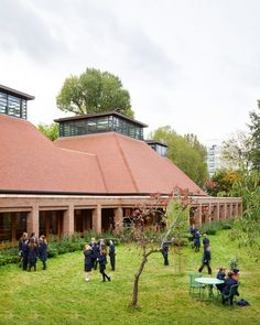 UK architecture studio Maccreanor Lavington has added a dining hall with a diamond-shaped glued laminated timber structure to the Ibstock Place School in Roehampton, west London. Timber Roof, Timber Buildings, The Block Kitchen, Brick Extension, School Site, Timber Structure, Interesting Buildings, London House, Ground Floor Plan