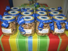 Sesame Street birthday party theme. Cookie Monster's mini cookie jars from baby food jars.