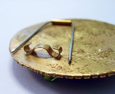 Simple Brooch Pin backs.  I've done a style that's very similar, but using round wire for the catch instead of flat