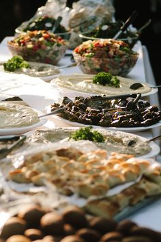 Greek weddings traditionally have buffets with foods from the cultures of both man and wife. Foods include fish, baklava, olives, salad, bread, kalamaria, pita, gyros and much more.