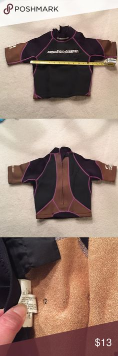 Maui & sons wet suit top 2/2 mm great condition 1st pic shows some wrinkles bc it was folded up...no flaws too cute even inside is great condition. Colors: black brown w/pink stitch Maui and Sons Shirts & Tops