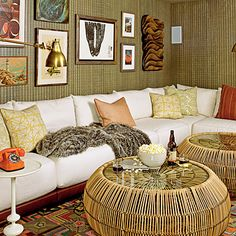 The giant, modular sectional in this media room is ready for a crowd! The couch is upholstered in durable, sand-friendly outdoor fabric, and the rattan tables serve the dual purpose of creating a tropical island feel and offering a spot for snacks, drinks, and propped-up feet.