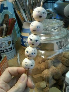Painted a faces on wooden beads for the Sachet Angel Ornaments I make!