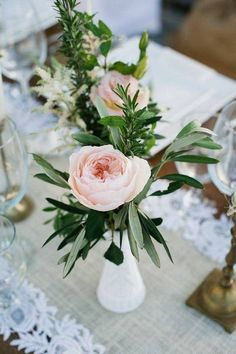 Spring Flower Arrangements pink flowers on a table