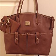 Dooney & Bourke NWOT Beautiful Authentic Leather Dooney ! Only used once or twice. Just was to big for me. Has been put away in my closet :) Dooney & Bourke Bags Totes