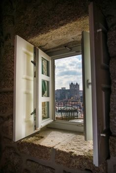 Oporto´s Cathedral through a small rustic house window by Jorge Quiroga...