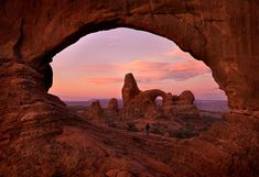 "THE GREAT WINDOW""  Arches National Park    A lone figure standing inside a massive window in Arches National Park at sunrise."